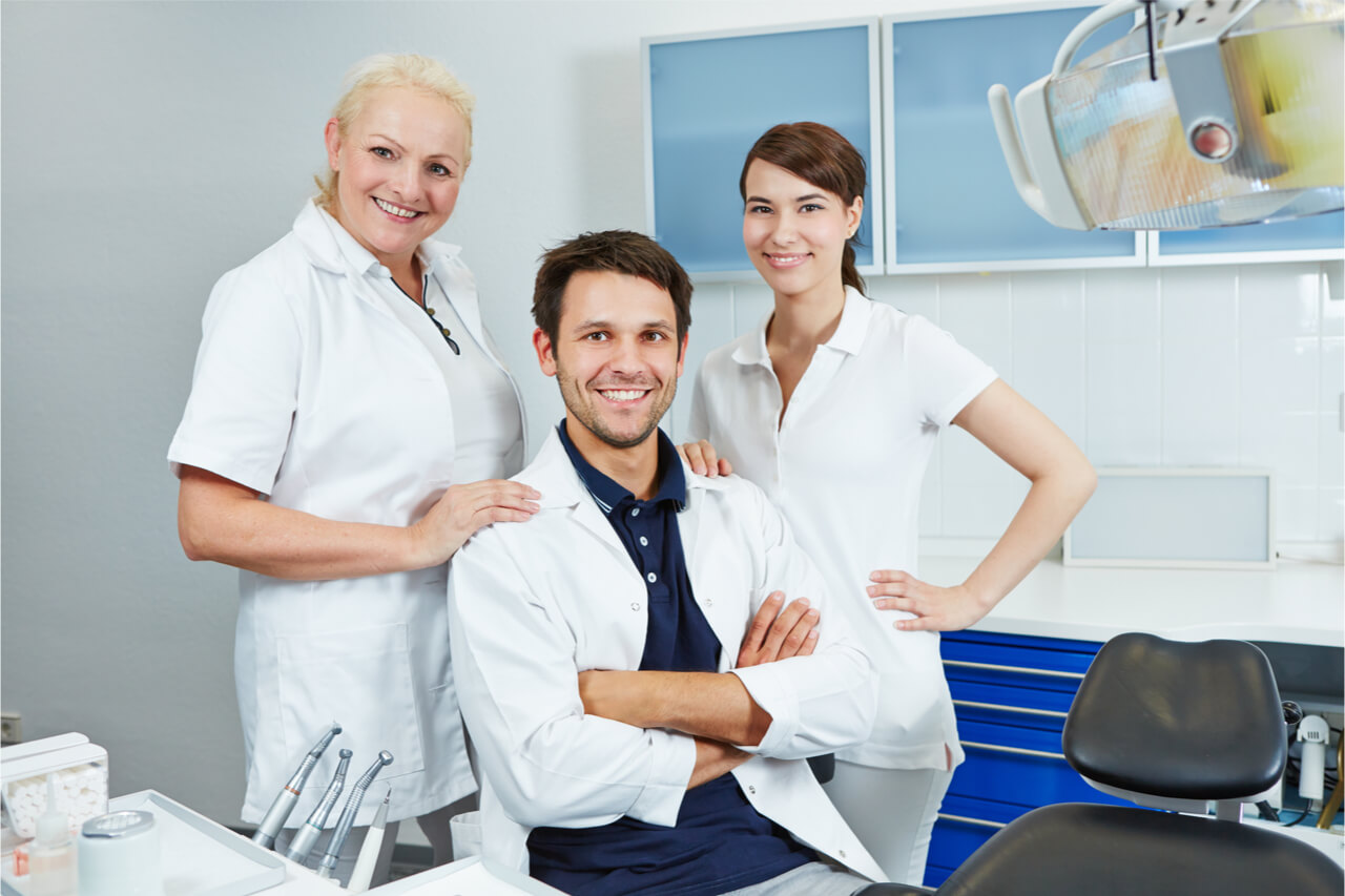 dentist with assistants