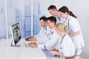 dentists studying an xray